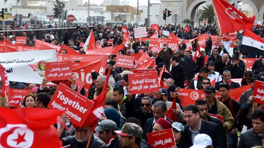 Protestors gather during an anti-extremism march, in Tunis, Sunday, March 29, 2015. Tens of thousands of Tunisians from across the political spectrum marched through the capital Sunday to denounce extremist violence after a deadly museum attack on foreign tourists. Hours ahead of the rally, security forces killed nine terrorist suspects in raids around the country. (AP Photo/Hichem Jouini)
