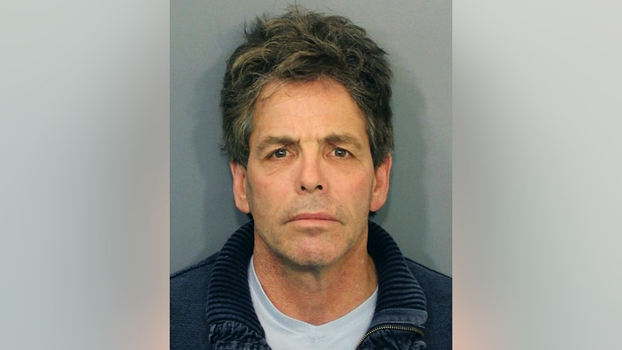 This booking photo released by the Fall River, Mass., Police Department shows Paul Haddad, 55, of Westwood, Mass., arrested and arraigned Friday, March 27, 2015, on charges he called in a bomb threat Thursday that forced the evacuation of the Massachusetts courthouse where former New England Patriots player Aaron Hernandez's murder trial is being held. Police said Thursday's threat had nothing to do with Hernandez. (AP Photo/Fall River Police Department)