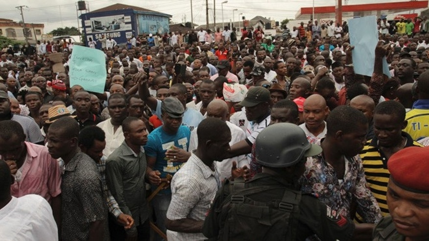 March 29, 2015: Security forces hold back protesters against the recent election in Port Harcourt , Nigeria.