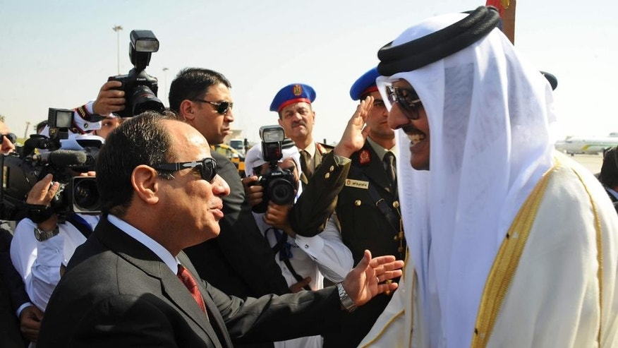 "Egyptian President Abdel Fattah al-Sisi, left, greets Qatar's Emir Sheikh Tamim bin Hamad Al-Thani, on his arrival to attend an Arab summit, in Sharm el-Sheikh, South Sinai, Egypt, Saturday, March 28, 2015. In a speech to Arab leaders, Yemen's embattled president on Saturday called Shiite rebels who forced him to flee the country ""puppets of Iran,"" directly blaming the Islamic Republic for the chaos there and demanding airstrikes against rebel positions continue until they surrender. (AP Photo/MENA)"