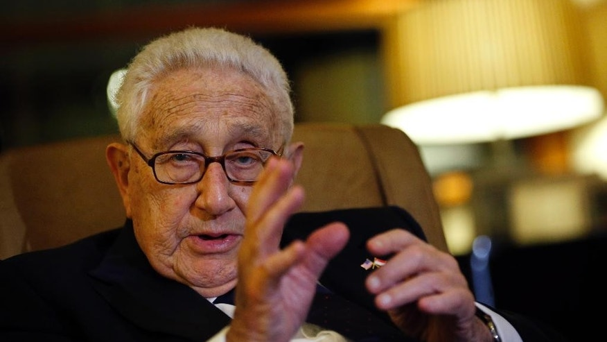 Former U.S. Secretary of State Henry Kissinger speaks to reporters after paying his respects to the late Lee Kuan Yew, Saturday, March 28, 2015, in Singapore. Lee, 91, died Monday at Singapore General Hospital after more than a month of battling severe pneumonia. The government declared a week of mourning for the leader who is credited with transforming the resource-poor island into a wealthy finance and trade hub with low crime and corruption in a region saddled with graft, instability and poverty. (AP Photo/Wong Maye-E)