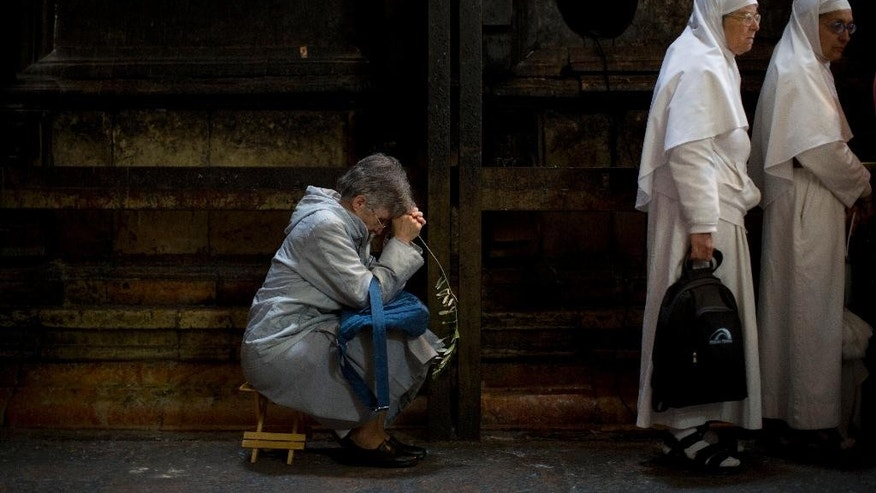 March 29, 2015: Christian worshipers gather at the Church of the Holy Sepulchre, traditionally believed by many to be the site of the crucifixion and burial of Jesus Christ, during Palm Sunday in Jerusalem's Old City.