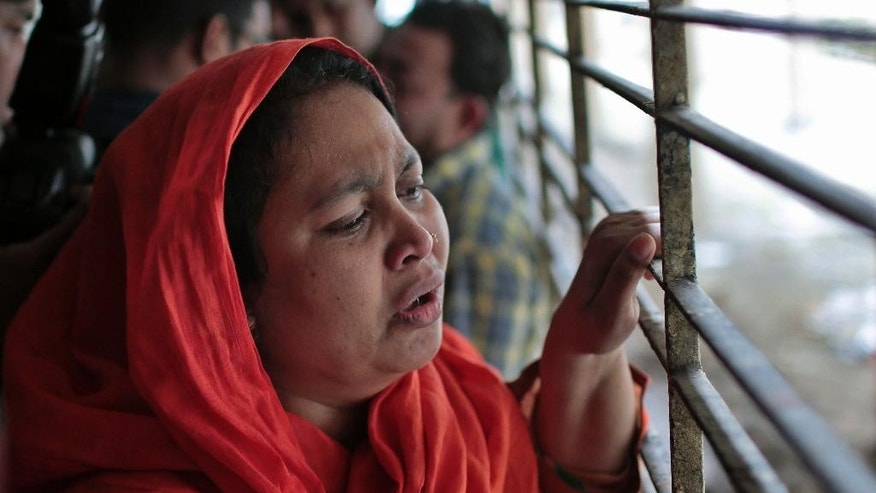 Shilpi, a cousin of late Bangladeshi blogger Washiqur Rahman Babu, wails outside a morgue at the Dhaka Medical College in Dhaka, Bangladesh, Monday, March 30, 2015. Babu, 26, was hacked to death by three men in Bangladesh's capital on Monday, police said. The killing took place a month after a prominent Bangladeshi-American blogger known for speaking out against religious extremism was hacked to death in Dhaka. (AP Photo/ A.M. Ahad)