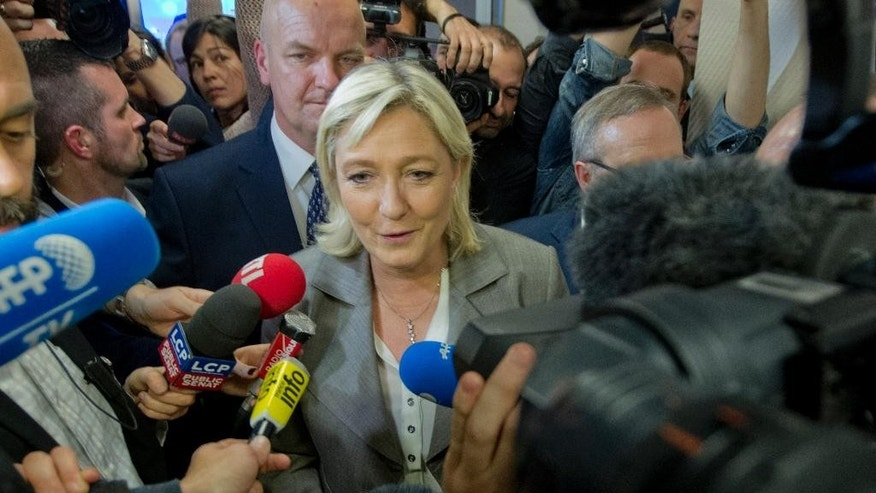French far-right National Front Party leader Marine Le Pen talks to the media at party headquarters, Sunday, March 29, 2015, in Nanterre, western Paris, France. French voters are choosing members of local councils in run off elections Sunday seen as a test for the far right National Front, which is expanding its presence in French politics. The mainstream conservative UMP party came out ahead in the first round, ahead of the National Front and the governing Socialists. (AP Photo/Jacques Brinon)