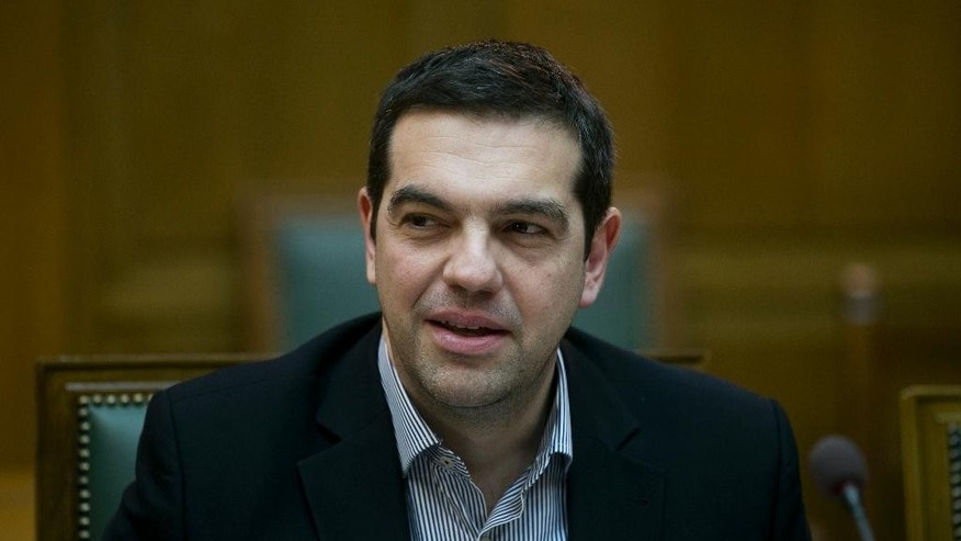 Greek Prime Minister Alexis Tsipras attends a Cabinet Meeting in Athens, on Sunday, March 29, 2015. Greece is going through difficult talks with its lenders with its cash reserves nearly depleted. (AP Photo/Petros Giannakouris)