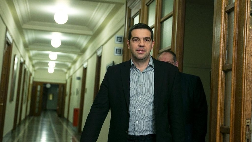 Greek Prime Minister Alexis Tsipras, arrives for a cabinet meeting in Athens, on Sunday, March 29, 2015.  (AP Photo/Petros Giannakouris)