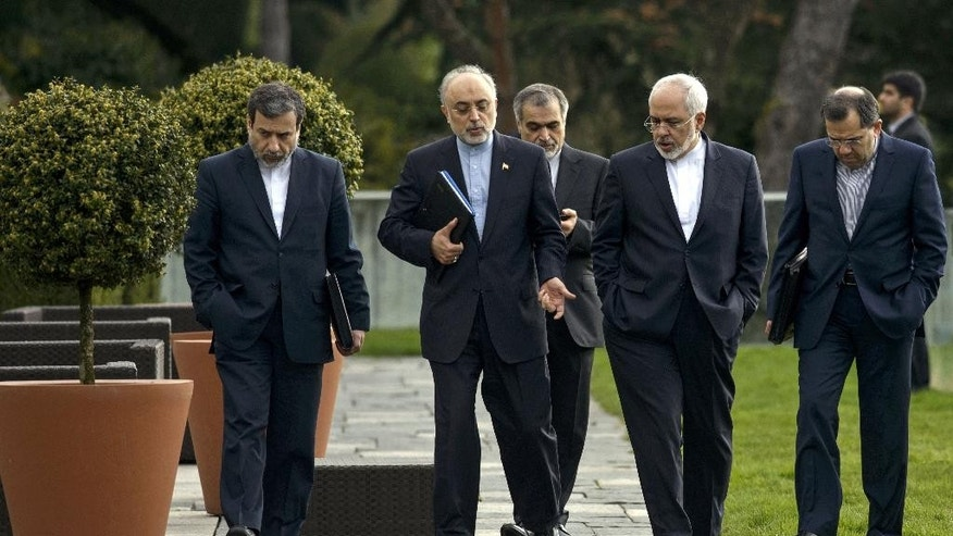 Head of Iranian Atomic Energy Organization, Ali Akbar Salehi, 2nd left, and Iranian Foreign Minister Javad Zarif, 2nd right, walk together during negotiations at an hotel in Lausanne, Switzerland, Sunday March 29, 2015. Iranian officials are meeting with representatives from world powers while in Switzerland for negotiations on Iran's nuclear program. (AP Photo/Brendan Smialowski, Pool)