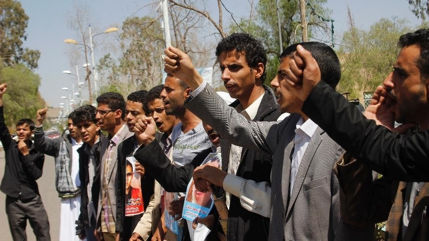 Yemenis chant slogans during a protest against Saudi-led airstrikes on Shiite rebels, known as Houthis, in Sanaa, Yemen, Monday, March 30, 2015. (AP Photo/Hani Mohammed)