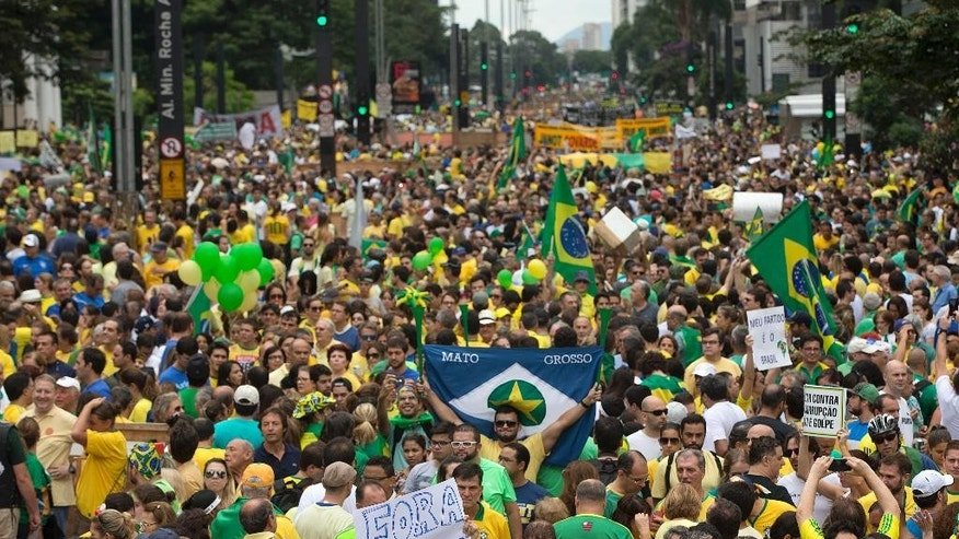 In this March 15, 2015 photo, demonstrators take part in a protest march demanding the impeachment of Brazil's President Dilma Rousseff, over an alleged scheme of corruption that siphoned money from the state-owned oil company Petrobras, in Sao Paulo, Brazil. The March 15 demonstration was the largest Sao Paulo had seen in more than three decades, since 1984 protests demanding democratic elections after a long dictatorship. (AP Photo/Andre Penner)