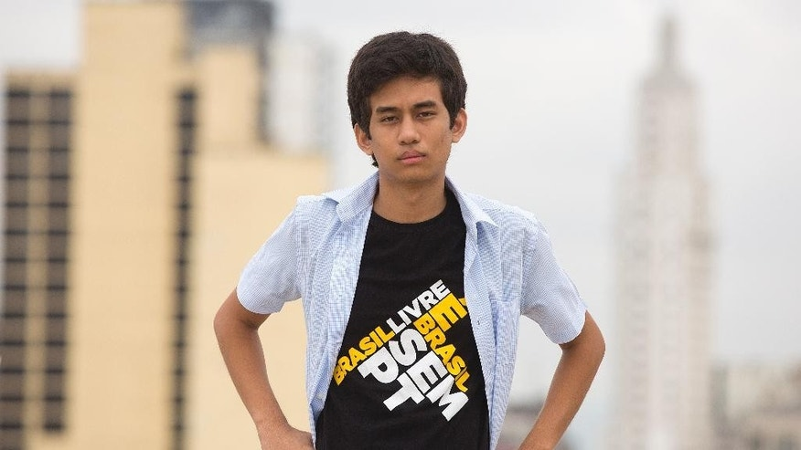 In this March 18, 2015 photo, anti-government protest leader Kim Kataguiri poses for a picture in Sao Paulo, Brazil. The grandson of Japanese immigrants, Kataguiri is a social media star whose quirky videos skewer Brazil's President Dilma Rousseff and the ruling party's social welfare policies. (AP Photo/Andre Penner)