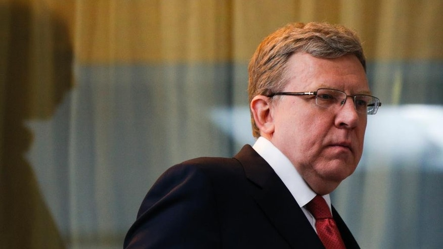 Russia's former finance minister Alexei Kudrin enters a hall to attend a round table to mark President Vladimir Putin's 15 years in office, some of the president's long-term allies questioned his political course and warned of economic fallout in Moscow, Russia, Tuesday, March 31, 2015.Kudrin, Russia's finance minister in 2000-2011 and a former deputy prime minister, said on Tuesday that Putin's focus on foreign policy means that Russia will not return in the coming years to the economic growth that would suit a great power that Putin wants it to see.  (AP Photo/Alexander Zemlianichenko)