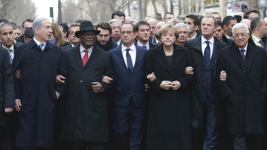 FILE - This Sunday, Jan. 11, 2015 file photo shows from left : Israeli Prime Minister Benjamin Netanyahu, Malian President Ibrahim Boubacar Keita, French President Francois Hollande, German Chancellor Angela Merkel, EU President Donald Tusk and Palestinian Authority President Mahmoud Abbas marching during a rally in Paris, France. France sees a window of opportunity after Israel's elections to get the United States on board with a new push for Mideast peace, and is preparing to present a draft U.N Security Council resolution in about 12 days, according to French diplomatic officials. The draft would define the pre-1967 frontier as a reference point for border talks but allow room for exchanges of territory, designate Jerusalem as a capital of two states and call for a fair solution for Palestinian refugees, one official told The Associated Press on Tuesday. (AP Photo/Philippe Wojazer, Pool, File)