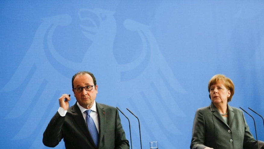 March 31, 2015: German Chancellor Angela Merkel and French President Francois Hollande brief the media after a meeting of German and French ministers in the chancellery in Berlin.