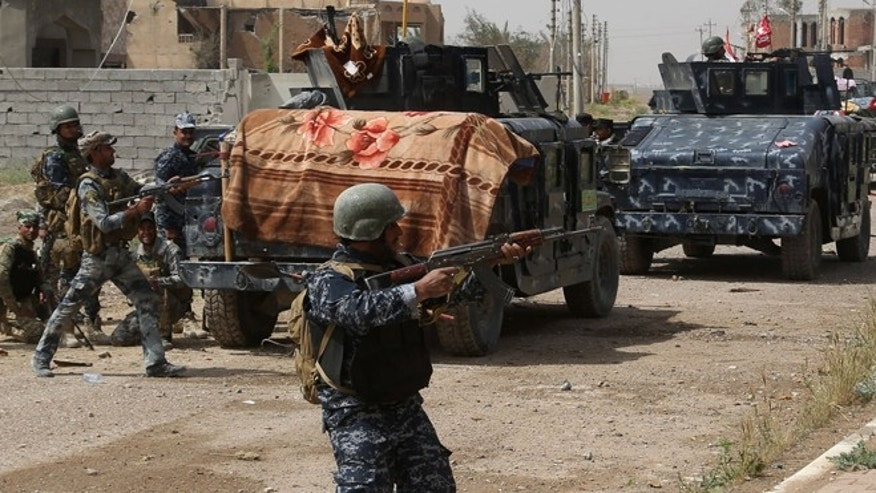 March 30, 2015: Iraqi security forces attack Islamic State extremists during clashes to regain the city of Tikrit, 80 miles north of Baghdad, Iraq.