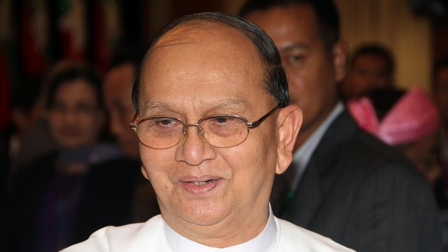 Myanmar President Thein Sein attends a signing ceremony of draft of the Nationwide Cease-fire Agreement (NCA) between representatives of the Myanmar government and armed ethnic groups Tuesday, March 31, 2015, in Yangon, Myanmar. Myanmar's government and 16 ethnic armed groups agreed Tuesday on the wording of a draft nationwide cease-fire agreement aimed at ending decades of civil unrest. (AP Photo/Khin Maung Win)