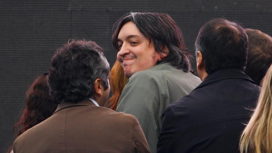 FILE - This April 27, 2012 file photo shows the son of Argentina's President Cristina Fernandez, Maximo Kirchner, smiling before attending a rally in Buenos Aires, Argentina. Maximo Kirchner is denying press reports alleging he had a foreign bank account that was used for Argentine dealings with Iran. Argentina's Clarin newspaper published a story in late March 2015 saying Maximo Kirchner and a former ambassador to Venezuela shared an account in the United States. The story cited anonymous sources. (AP Photo/Natacha Pisarenko, File)