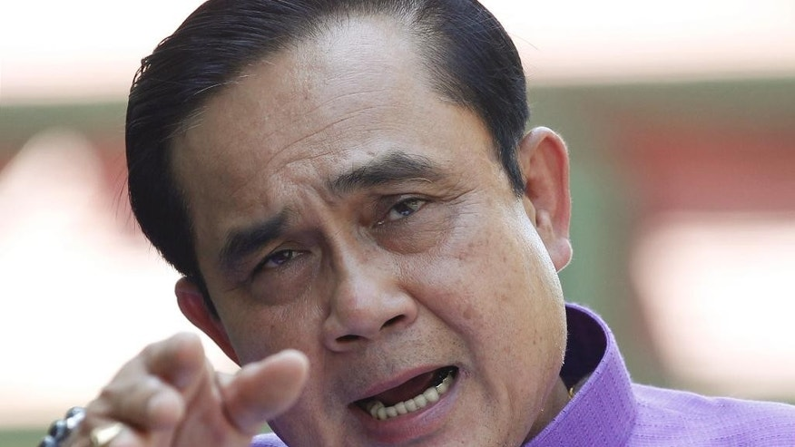 Thailand's Prime Minister Prayuth Chan-ocha answers questions from reporters during a press conference at the government house in Bangkok, Thailand, Tuesday, March 31, 2015. Thailand's prime minister has asked the king for formal approval to lift martial law, which the military imposed ahead of a coup last May that overturned an elected government. The monarch's approval is considered a formality. (AP Photo/Sakchai Lalit)