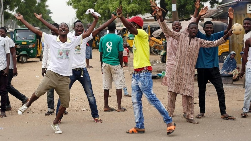 "Residents celebrate the anticipated victory of Presidential candidate Muhammadu Buhari  in Kaduna,  Nigeria Tuesday, March 31, 2015. Former military dictator Muhammadu Buhari has won Nigeria's presidential election but fears his victory could be stolen by ""tricks"" from the government, his spokesman, Garba Shehu, told The Associated Press on Tuesday. (AP Photo/Jerome Delay)"