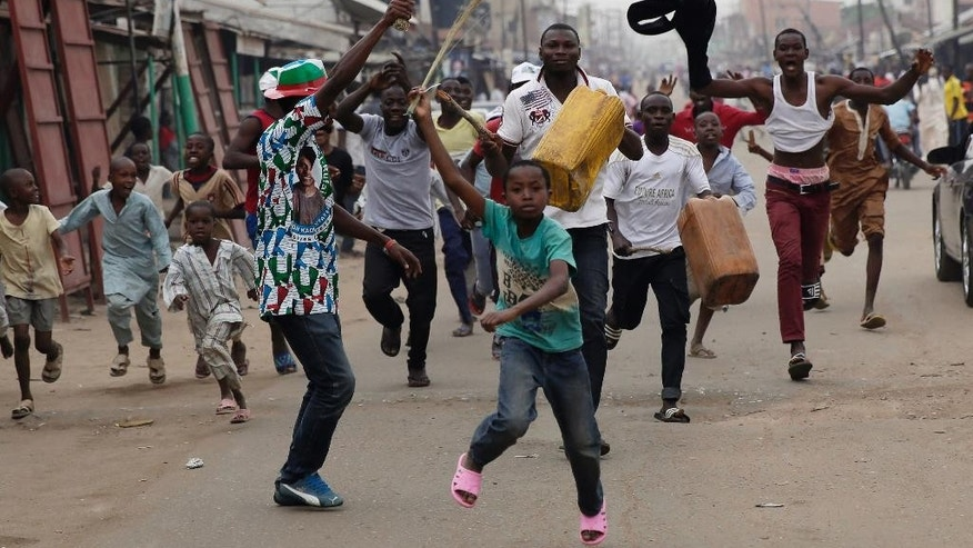 "Residents celebrate the anticipated victory of Presidential candidate Muhammadu Buhari in Kaduna,  Nigeria Tuesday, March 31, 2015. The spokesman for retired Gen. Muhammadu Buhari says the former military dictator has won Nigeria's bitterly contested presidential election but fears ""tricks"" from the government. Garba Shehu tells The Associated Press that their polling agents across the country tell them they have succeeded in defeated President Goodluck Jonathan. (AP Photo/Jerome Delay)"