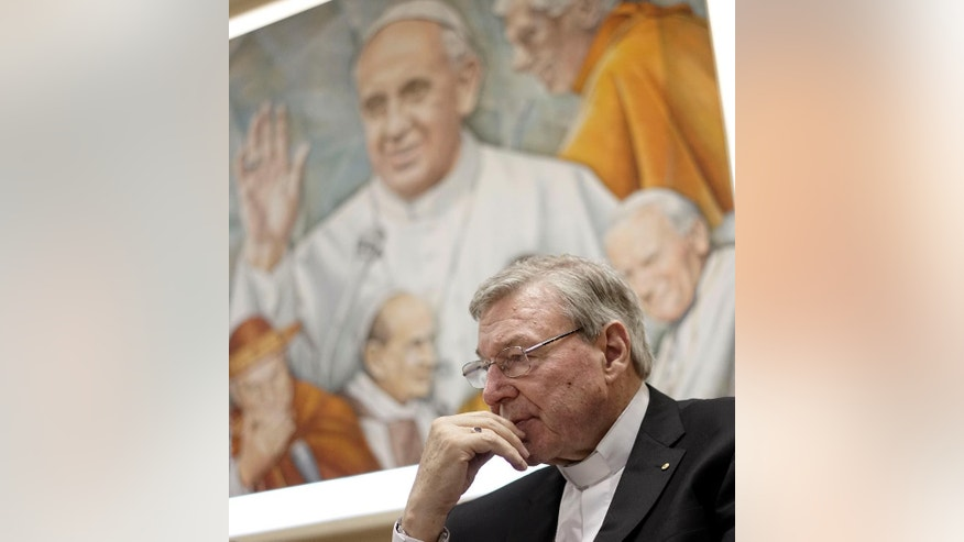 Cardinal George Pell attends a press conference at the Vatican Radio headquarters, in Rome, Tuesday, March 31, 2015. The Vatican finance minister has said he hopes to avoid financial scandal with the upcoming Jubilee year, saying the plans will be subject to new Vatican procedures to ensure they follow international standards for transparency and accountability. Cardinal George Pell outlined the Vatican's financial reform during a conference Tuesday to launch a book on better managing church assets, a priority for Pope Francis after years of financial scandal and mismanagement at the Holy See. (AP Photo/Andrew Medichini)