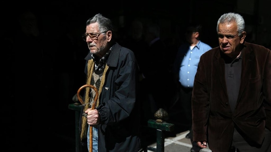 Pensioners take part in a anti-austerity protest, outside the Labor ministry, in central Athens, on Wednesday, April 1, 2015. Greece and its international creditors are still struggling to agree on a list of economic reforms that are deemed necessary for the country to unlock emergency funds and stay afloat. (AP Photo/Petros Giannakouris)