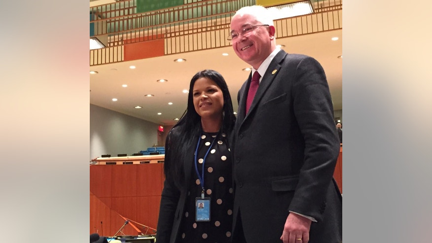 Maria Gabriela Chavez, the daughter of late Venezuelan leader Hugo Chavez, poses with Venezuela's ambassador to the United Nations, Rafael Ramirez, Wednesday, April 1, 2015 at United Nations headquarters. Chavez is Venezuela's deputy permanent representative to the United Nations. (AP Photo/Cara Anna)