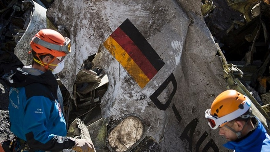 March 31, 2015: In this photo taken and provided by the French Interior Ministry, French emergency rescue services work among debris of the Germanwings passenger jet at the crash site near Seyne-les-Alpes, France.