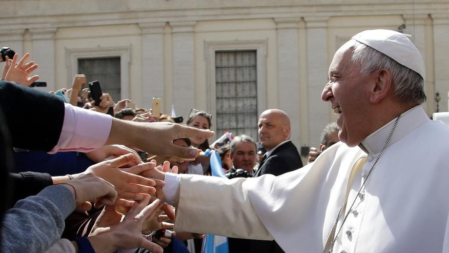 Pope Francis is cheered by faithful as he leaves St. Peter's Square at the end of the weekly general audience at the Vatican, Wednesday, April 1, 2015. (AP Photo/Gregorio Borgia)