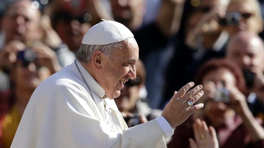Pope Francis waves to the crowd as he arrives in St. Peter's Square for his weekly general audience at the Vatican, Wednesday, April 1, 2015. (AP Photo/Gregorio Borgia)