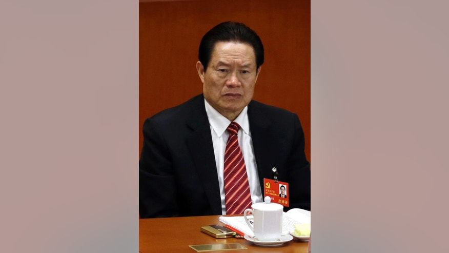 FILE - In this Nov. 8, 2012 file photo, Zhou Yongkang, then Chinese Communist Party Politburo Standing Committee member in charge of security, sits during the opening session of the 18th Communist Party Congress in Beijing, China. Chinese government prosecutors announced Friday, April 3, 2015 that Zhou has been formally charged with corruption and leaking of state secrets, setting the stage for him to become the highest-level politician to stand trial in China in more than three decades. (AP Photo/Ng Han Guan, File)