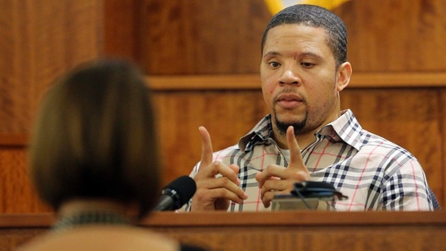 Prosecution witness Alexander Bradley describes a gun he saw with former New England Patriots NFL football player Aaron Hernandez on a trip to Florida as Bradley testifies during Hernandez's murder trial, Wednesday, April 1, 2015, at Bristol County Superior Court in Fall River, Mass. Hernandez is accused of killing Odin Lloyd in June 2013.  (AP Photo/Brian Snyder, Pool)