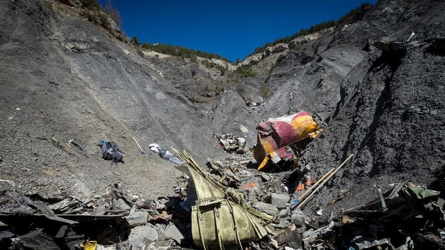 In this photo taken on Tuesday, March 31, 2015 and provided by the French Interior Ministry shows debris of the Germanwings passenger jet at the crash site near Seyne-les-Alpes, France. The heads of Lufthansa and its low-cost airline Germanwings are visiting the site of the crash that killed 150 people amid mounting questions about the co-pilot and how much his employers knew about his mental health. (AP Photo/Yves Malenfer, Ministere de l'Interieur)