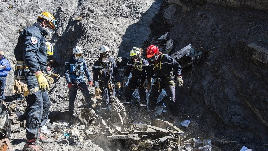 Mountain troops, police and gendarme officer  listen during a briefing before heading to the crash site, Thursday, April 2, 2015 in Seyne-les-Alpes, France. Investigators believe co-pilot Andreas Lubitz intentionally crashed the Germanwings A320 into a mountainside, based on recordings from the cockpit voice recorder, killing 150 people. Special mountain troops continued searching the area for personal belongings and the second black box flight recorder (AP Photo/Claude Paris)