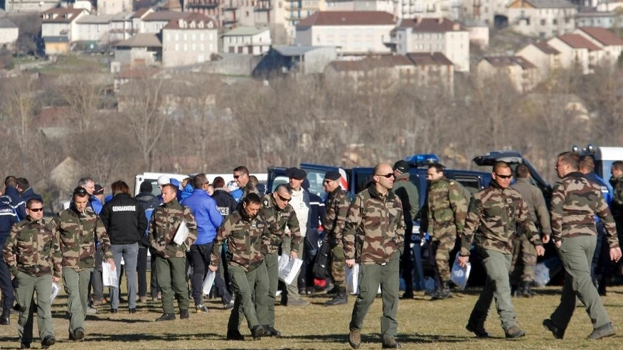 Soldiers leave after a briefing and before heading to the crash site, Thursday, April 2, 2015 in Seyne-les-Alpes, France. Investigators believe co-pilot Andreas Lubitz intentionally crashed the Germanwings A320 into a mountainside, based on recordings from the cockpit voice recorder, killing 150 people. Special mountain troops continued searching the area for personal belongings and the second black box flight recorder (AP Photo/Claude Paris)