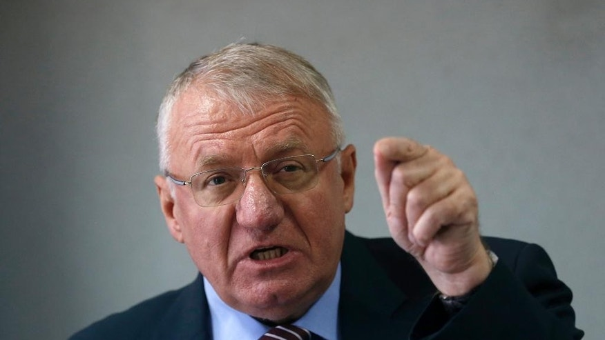 Serbian far right leader Vojislav Seselj, who is accused of war crimes by a U.N. court, speaks during a press conference in Belgrade, Serbia, Thursday, April 2, 2015. Serbian and Croatian officials have sought to defuse tensions between the two Balkan states that have soared after a Serb far-right leader burned a Croatian flag while defying orders to return to the U.N. war crimes tribunal. (AP Photo/Darko Vojinovic)