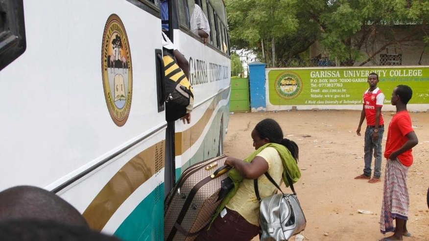 A university student gets on a bus at the gate of the Garissa University College in Garissa, northeastern Kenya, Friday, April 3, 2015. Al-Shabab gunmen rampaged through the university at dawn Thursday, killing over 100 people in the group's deadliest attack in the East African country. (AP Photo/Khalil Senosi)
