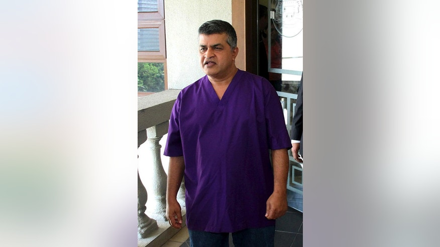 Malaysian cartoonist Zulkiflee Anwar Alhaque, better known as Zunar leaves the courthouse in Kuala Lumpur, Malaysia, Friday, April 3, 2015. The Malaysian cartoonist known for lampooning the ruling coalition was charged Friday with nine counts of sedition over a series of tweets criticizing the country's judiciary. (AP Photo)
