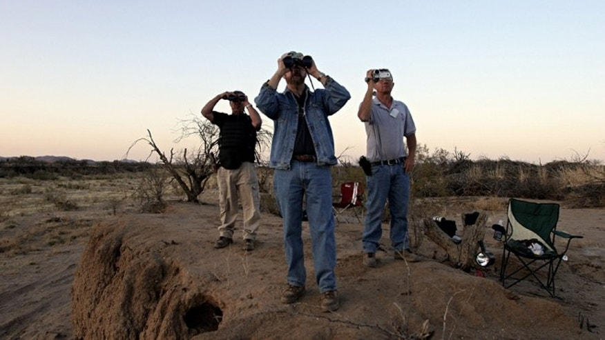 THREE POINTS, AZ - APRIL 1:  (L-R)  Minutemen Tony Ford, Vic Roman and Jeff Almli continue to search for a group of 12 undocumented immigrants after Roman spotted them from their post in the Altar Valley April 1, 2006 in the Sonoran Desert 35 miles south of Tucson, Arizona. Roman reported sighting the immigrants who were later captured by the Border Patrol.  Approximately 100 volunteers from several states came to Arizona to participate in the third month-long action near the U.S. and Mexican borders searching for those entering the country illegally. Minutemen will also be stationed near the border with California, New Mexico and Texas. Chris Simcox, the leader of the Arizona Minutemen announced that there are now 7,000 registered Minutemen throughout the U.S.  (Photo by Jeff Topping/Getty Images)