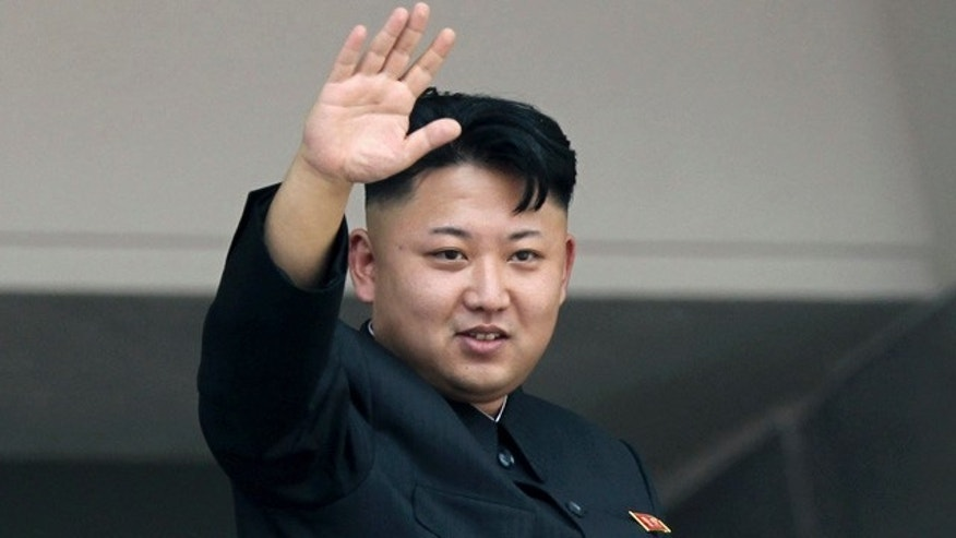 FILE - In this July 27, 2013 file photo, North Korean leader Kim Jong Un waves to spectators and participants of a mass military parade celebrating the 60th anniversary of the Korean War armistice in Pyongyang, North Korea. (AP Photo/Wong Maye-E, File)