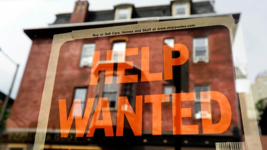 FILE - In this Aug. 19, 2013 file photo, a Philadelphia business displays a help wanted sign in its storefront. The Labor Department releases weekly jobless claims on Thursday, April 2, 2015. (AP Photo/Matt Rourke, File)