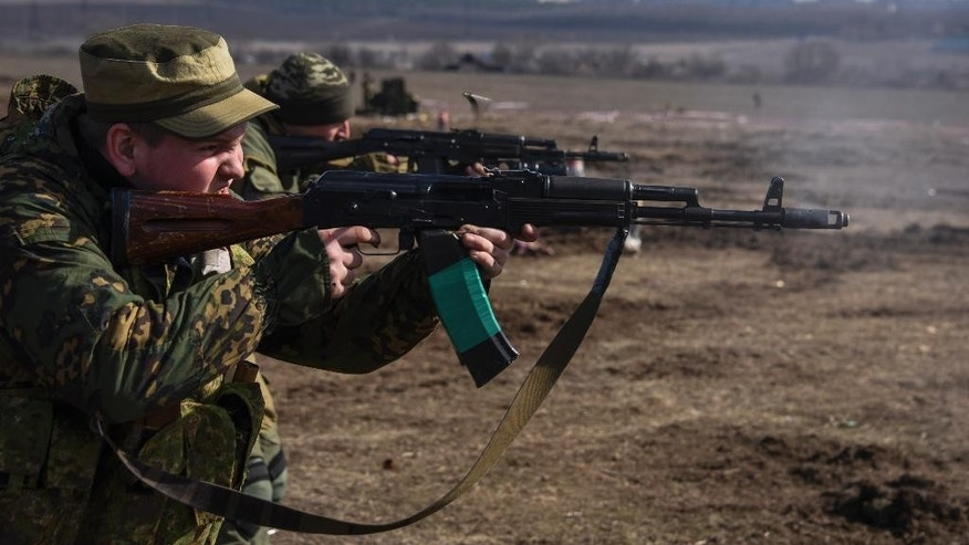In this Wednesday, March  11, 2015 photo, pro-Russian rebels participate in a military training exercise near Yenakiyeve, in the Donetsk region of eastern Ukraine. AP reporting, based on dozens of conversations with rebel fighters and visits to their training grounds, has revealed the extent of the involvement of Russian troops in the year-long conflict. (AP Photo/Mstyslav Chernov)