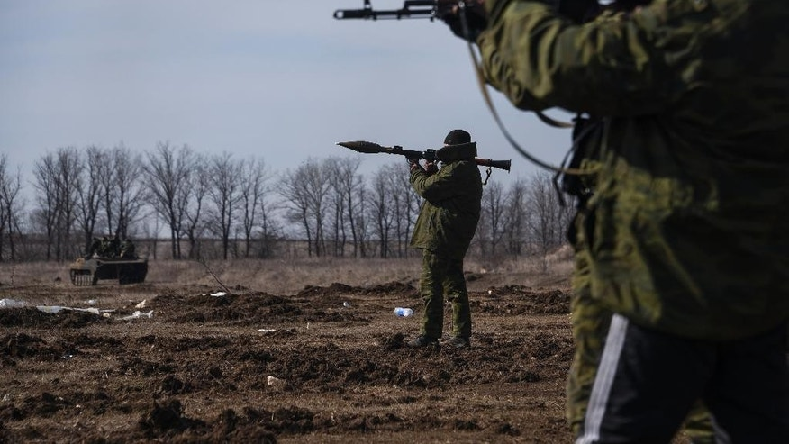 In this Wednesday, March  11, 2015 photo, pro-Russian rebels participate in a military training exercise, near Yenakiyeve in the Donetsk region of eastern Ukraine. AP reporting, based on dozens of conversations with rebel fighters and visits to their training grounds, has revealed the extent of the involvement of Russian troops in the year-long conflict. (AP Photo/Mstyslav Chernov)