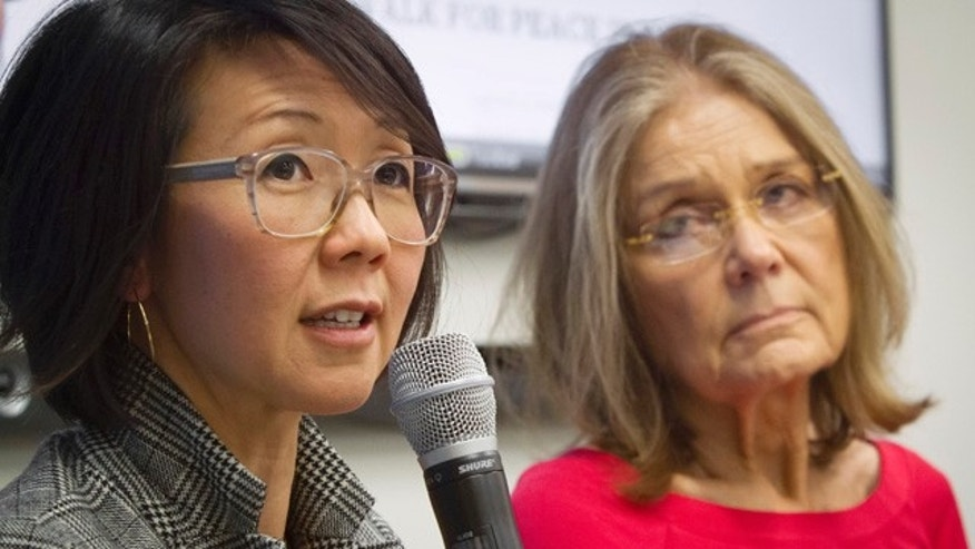 FILE - Organizers of the effort called WomenCrossDMZ.org, including lead coordinator Christine Ahn, left, and  honorary co-chair Gloria Steinem, right, hold a United Nations news conference announcing plans for a rare and risky women's walk across the demilitarized zone between North and South Korea to call for reunification, in this March 11, 2015 file photo. (AP Photo/Bebeto Matthews, File)