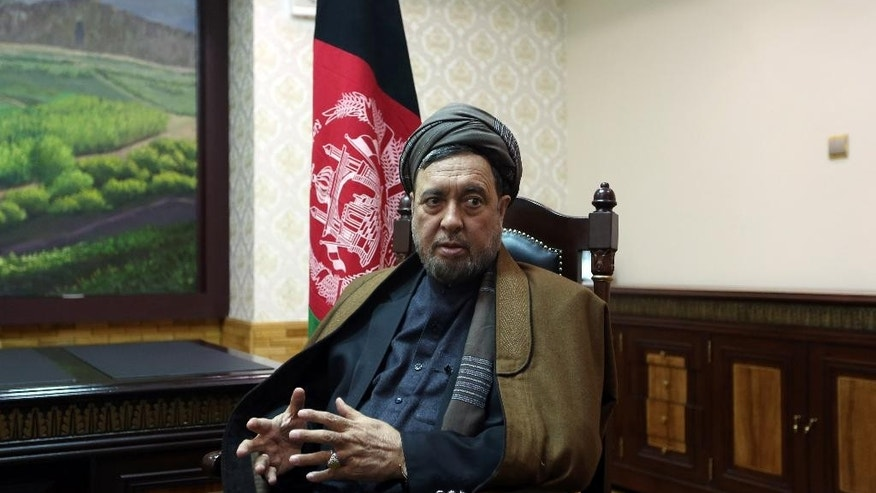 Mohammad Mohaqiq, deputy to Afghanistan's Chief Executive Abdullah Abdullah, speaks during an interview with The Associated Press in Kabul, Afghanistan, Saturday, April, 4, 2015. Mohaqiq, Afghanistan's senior Shiite community leader, said on Saturday the Islamic State group is responsible for the abduction of 31 members of the minority Shiite Hazara community on Feb. 24 in the southern Zabul province.  (AP Photo/Rahmat Gul)