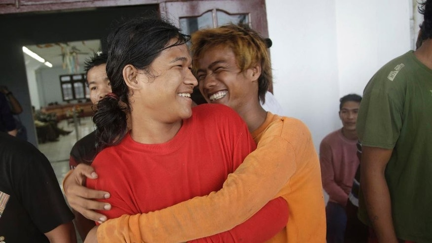 Burmese fishermen hug each other as they wait for their departure to leave the compound of Pusaka Benjina Resources fishing company in Benjina, Aru Islands, Indonesia, Friday, April 3, 2015. Hundreds of foreign fishermen on Friday rushed at the chance to be rescued from the isolated island where an Associated Press report revealed slavery runs rampant in the industry. Indonesian officials investigating abuses offered to take them out of concern for the men's safety. (AP Photo/Dita Alangkara)