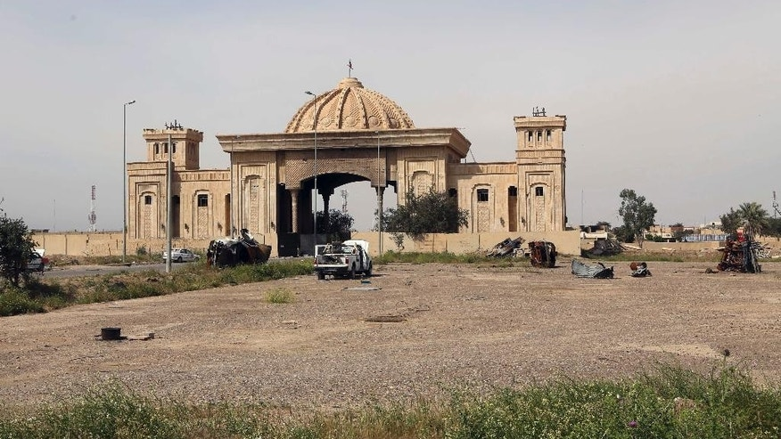 Destroyed vehicles are seen in one of Saddam Hussein's palaces in Tikrit, 80 miles (130 kilometers) north of Baghdad, Iraq, Friday, April 3, 2015. (AP Photo/Khalid Mohammed)