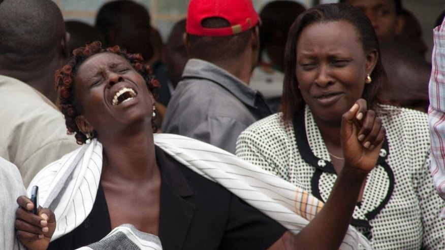 A woman  cries after she viewed the body of a relative killed in Thursday's attack on a university, at Chiromo funeral home, Nairobi, Kenya, Saturday, April 4, 2015. Al-Shabab gunmen rampaged through a university in northeastern Kenya at dawn Thursday, killing scores of people in the group's deadliest attack in the East African country. Four militants were slain by security forces to end the siege just after dusk. (AP Photo)