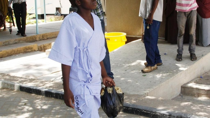 A university student, one of the survivors walks at the Garissa Hospital, in Garissa  Kenya, Friday, April 3, 2015. Al-Shabab gunmen rampaged through the university at dawn Thursday, killing over 100 people in the group's deadliest attack in the East African country. (AP Photo/Khalil Senosi)