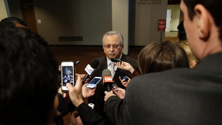 Saudi Arabia Ambassador to the United Nations Abdallah Y. Al-Mouallimi, center, speaks to reporters outside a Security Council consultation Saturday, April 4, 2015, at the United Nations headquarters. Saudi Arabia is ready to discuss Russia's proposition to introduce pauses in air strikes on Yemen for delivering humanitarian aid and evacuating civilians. (AP Photo/Mary Altaffer)