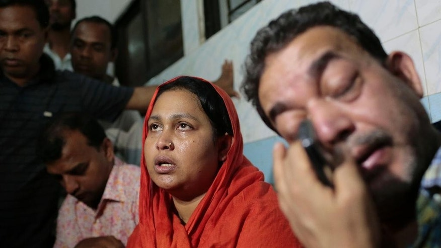 In this Monday, March 30, 2015 photo, relatives of the late Bangladeshi blogger Qyasiqur Rahman Babu cry outside a morgue at the Dhaka Medical College in Dhaka, Bangladesh. The blogger, 27, was hacked to death by three men in Bangladesh's capital on Monday, police said. The killing took place a month after a prominent Bangladeshi-American blogger known for speaking out against religious extremism was hacked to death in Dhaka. (AP Photo/A.M. Ahad)